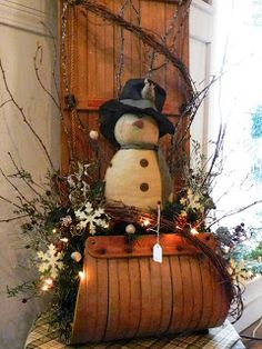 "For January...when the snowmen come out! sled decor C & C Furnishings (Love the price tag...so ""homey!"")"