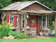 Playhouse Now Garden Shed. (I love this, it has so much appeal, especially with the red accents