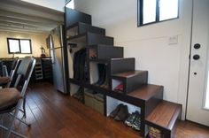 Conceived by Andrew and Gabriella Morrison in their quest to escape the rat race and completely change their way of living, 'hOMe' a tiny house on wheels. Tiny House Stairs, Building A Tiny House, House 2, Tiny House Movement, Modern Tiny House, Tiny House Design, Tiny House France, Staircase Storage, Stair Storage