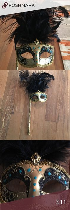 Hand painted masquerade mask handheld on stick Very pretty and blacks and gold with a touch of teal.  Carried ones to a masquerade event in good used condition Other