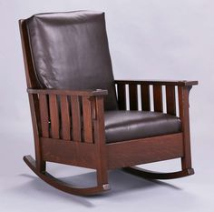 Gustav Stickley #323 slatted rocker.  Signed with red decal.  Refinished.