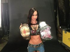 Photo Of WWE Divas Champion AJ Lee Posing With The Former WWE Woman's Title Belt | PWMania
