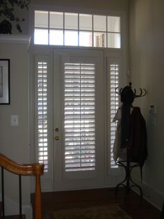 Plantation Shutters On A Front Door And Sidelights.