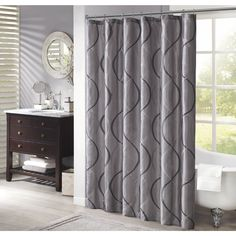 Madison Park Marcel is the essence of chic. The two-tone embroidered ogee on iridescent ivory/ charcoal/navy taffeta creates a more elegant feel to your space.