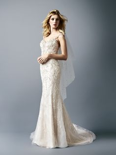 @valstefani wedding dress with a sweetheart neckline and beaded detailing all throughout.