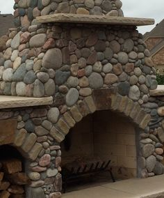 River Rock Fireplace built by Green Meadows Landscaping.