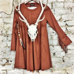 - Pseudo Suede Trapeze Dress - Super Haute Open Back Panel - Pistol Slinger Fringe Sleeves - Model is 5'5, size 0 and is wearing a Small - Made in America S M L Bust 38 40 42 Waist 55 58 62 Hips 74 79