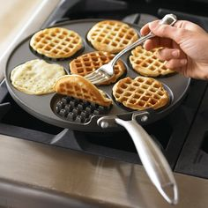 Make the perfect mini waffles with the Waffle Pancake Pan! This innovative cast-aluminum griddle from Nordic Ware allows you to create 7 waffles in a jiffy.Cool Kitchen Gadgets - Love this waffle pan! Oh Williams Sonoma you and your crafty kitchen gadgets Cool Kitchen Gadgets, Home Gadgets, Cooking Gadgets, Kitchen Items, Kitchen Hacks, Cool Kitchens, Kitchen Stuff, Cooking Tools, Kitchen Products