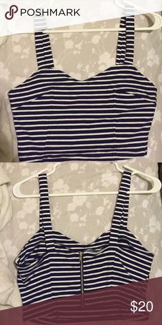 Striped crop top The stripes are dark blue and white. You should really take your bra size into account when buying this. I'm a 32DDD and it BARELY is too small for me. I think anyone from C to DD would be able to be comfortable in this. I've never worn it aside from trying it on (I got it as a gift).             (Make an offer, must go by September) Forever 21 Tops Crop Tops