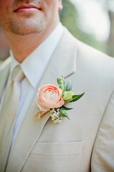 coral ranunculus boutonniere— Megan & Brett on Borrowed & Blue. Photo Credit: Kristyn Hogan