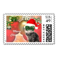 Holiday cat on christmas ornaments background postage stamp