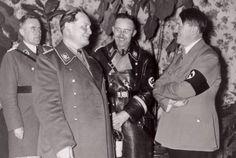 Hermann Goering, Heinrich Himmler, and Adolf Hitler smiling and laughing