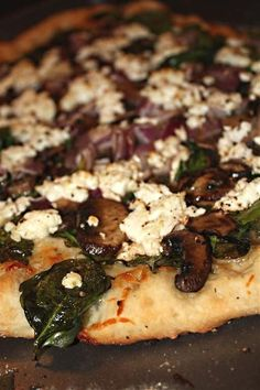 This spinach mushroom red onion goat cheese pizza is packed full of flavor and ready in just under 30 minutes. It's the perfect summer pizza!