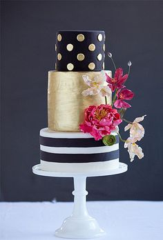 Brides: A Modern, Black and Gold Wedding Cake. Planning a whimsical wedding with mod, mid-century inspired details? Get inspired by this adorable Wild Orchid Baking Company cake, which uses brushed gold details to add sophistication%u2014and some flowers and polka dots to keep it fun.