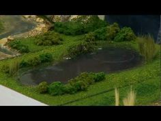 ▶ Realistic Water & Water Effects - Model Scenery | Woodland Scenics - YouTube - Wonder if I could do this with a more icy blue color for a snowy type river, also add some white ski marks where skiiers have been skiing on the lake!