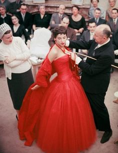 Christian Dior making adjustments to a gown, photo by Mark Shaw, 1954