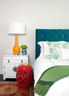 turquoise headboard + green accents + orange lamp + red decor // bedroom inspiration