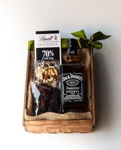 The Jack Pack from Bespoke Bouquet R699  A great Father's Day gift idea.  Served on ice, with a dash of water or with a favourite mixer, Jack Daniel's Tennessee Whiskey is a firm favourite. The Jack Pack includes a bottle of Jack itself, paired with an edible selection of biltong, mixed nuts and Lindt chocolate.
