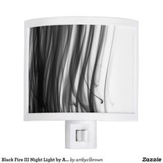 The Black Fire III Night Light designed by Artist C.L. Brown features fire photography converted to black and white. Now you don't have to be afraid of the dark! Light up any room with a one-of-a-kind night light to fit perfectly with your personality and décor. Type A plug, compatible with sockets in USA, Canada, Mexico and Japan. Designable area easily pops out and rotates to match electrical outlets with the ground pin at the top or bottom. A light bulb is included and the product…