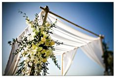 The canopy was contstructed of white linen and had beautiful, white flowers trailing down the side.