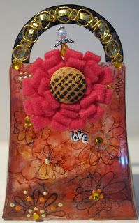 This oh so cute purse was created by Pinquette Mary using Pinque Peacock Fabric Flowers, Fabric Covered Buttons and Beaded Stick Pin
