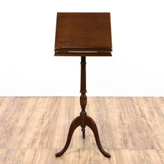 This music stand is featured in a solid wood with a glossy mahogany finish. This contemporary style lectern has a carved turning pedestal base and curved legs. Perfect for the classroom! #contemporary #tables #endtable #sandiegovintage #vintagefurniture