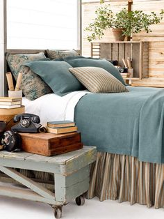 lovely rustic touches and pretty bedding! (this link leads to a store)