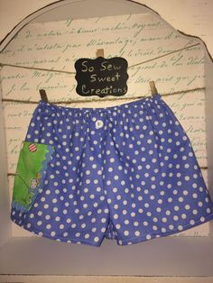 Easter Baby/Toddler shorts, polka dot blue and white with tiny green and blue pocket on side with an Easter Bunny pulling a cart of eggs. by SoSewSweetCreations on Etsy
