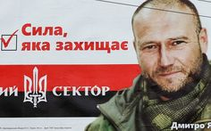 "A pre-election poster with a portrait of Dmytro Yarosh, leader of nationalist party Right Sector is seen at the street in Kiev, October 22, 2014. Ukrainians will take part in an early parliamentary election on October 26. The poster reads: ""The power which defends. Right Sector""."