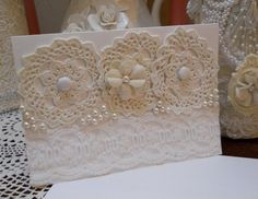 Handmade Greeting Card for all occassions, white heavy card stock, cream, white, ivory, vintage doilies, vintage lace, fabric flower with rhinestone,buttons, blank inside with matching envelope. Will be send in protective Cellophane sheet. Give for birthdays, special holidays, friendship, teacher's gifts, great for giving out at home shopping parties, bridal shower gifts for door prizes, additional gift basket item, secret pal or just keep for yourself