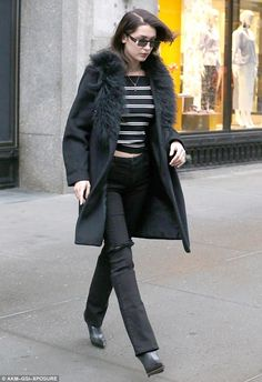 Leggy: The leggy brunette wore a pair of slim black pants that sat low at the hips letting her midriff peek out
