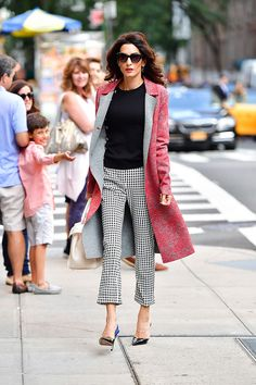 Leave it to Amal Clooney to set the bar for chic fall weather dressing. Yesterday the lawyer and activist stepped out in New York City wearing a complete Altuzarra look, including gingham pants and floral brocade coat from the label's Pre-Spring 2017 collection. Love the look? Follow this fashion muse's pattern-mixing lead by pairing two contrasting prints with a few solids — like her classic black sweater, pumps, and cat-eye sunglasses