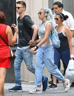 Summer of love: Lourdes Leon held hands with a male pal as she stepped out on a summer str...