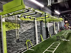 Custom functional training station wall bridge suspended over turf area leaving more training space. 30 Nova FTS wall bridge in custom colors. Wall post support bridge and offer different training options. Plan Garage, Home Gym Garage, Fitness Gym, Fitness Workouts, Fitness Shirts, Fitness Studio, Kine Sport, Nashville, Sport Studio