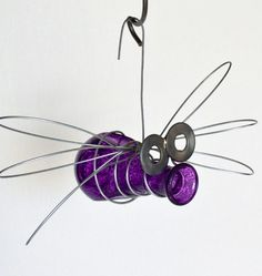 Dollar store/thrift store mini vases, wire, washers and imagination makes little garden bugs