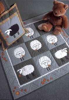 Sheep in the Meadow by Stash Buster Quilts pattern published in Stash-Buster Quilts: Time-Saving Designs for Fabric Leftovers by Lynne Edwards from $2.51 on Amazon at http://www.amazon.com/s/ref=nb_sb_noss?url=search-alias%3Dstripbooks=Stash-Buster%20Quilts%20Timesaving%20designs%20for%20fabric%20leftovers