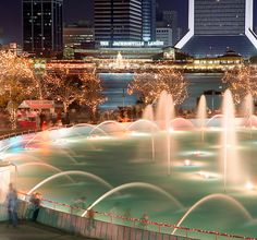 Friendship Fountain in the foreground with the Jacksonville Landing in the background in Jacksonville, Florida.