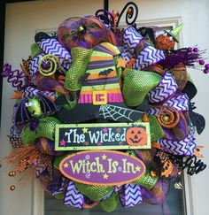 This fun whimsical Witch wreath is sure to make a great impression on your neighbors and guests this Halloween! It would look great as a decoration