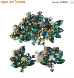 This is a fabulous Vintage Spray Floral Brooch or Pendant and Earrings Set in Blue & Emerald Green and Aurora Borealis Rhinestones!   This brooch has a bail on the back so ... #teamlove #ecochic #vogueteam