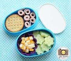 afternoon nutrition break - whole wheat crackers, turkey roll-ups, flower-cut cucumbers, marble cheese