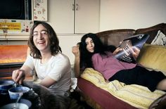 ♡♥John Lennon 28 relaxes eating a bowl of soup while with Yoko Ono 35 who lays on the couch reading a magazine in December 1968♥♡