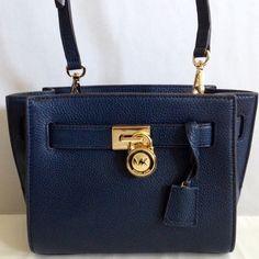 Michael Kors navy blue leather crossbody NWT Navy blue leather Hamilton Traveler with detachable adjustable strap, gold tone hardware, 1 interior zip pocket and slot pocket. Approx 8.5Lx7.5Hx4W. Michael Kors Bags Crossbody Bags