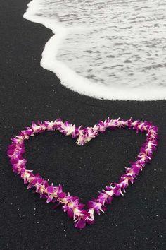 Hawaiian Lei on the famous black sands of Hawaii~