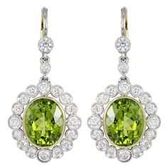 Peridot Diamond Gold Platinum Drop Earrings | From a unique collection of vintage dangle earrings at https://www.1stdibs.com/jewelry/earrings/dangle-earrings/