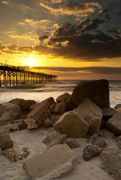 sunrise over a carolina beach pier