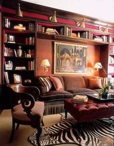 Home Library Design bookshelf lighting. Red and dark brown for the library