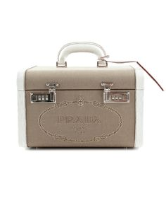 Chic Accessory: Prada Cosmetic Case. (TheRealReal.com)
