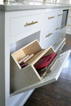 Pull down drawer for cutting boards and racks