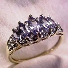 10K Solid Gold with Genuine Tanzanite and Diamonds Marquise cut tanzanite stone with genuine diamonds. Size 4.74 but Can be resized. Free shipping on Ⓜ️. Jewelry Rings