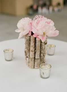 blush peonies with birch wood vase. love the colors, flowers, votives, etc. all of it. basically.